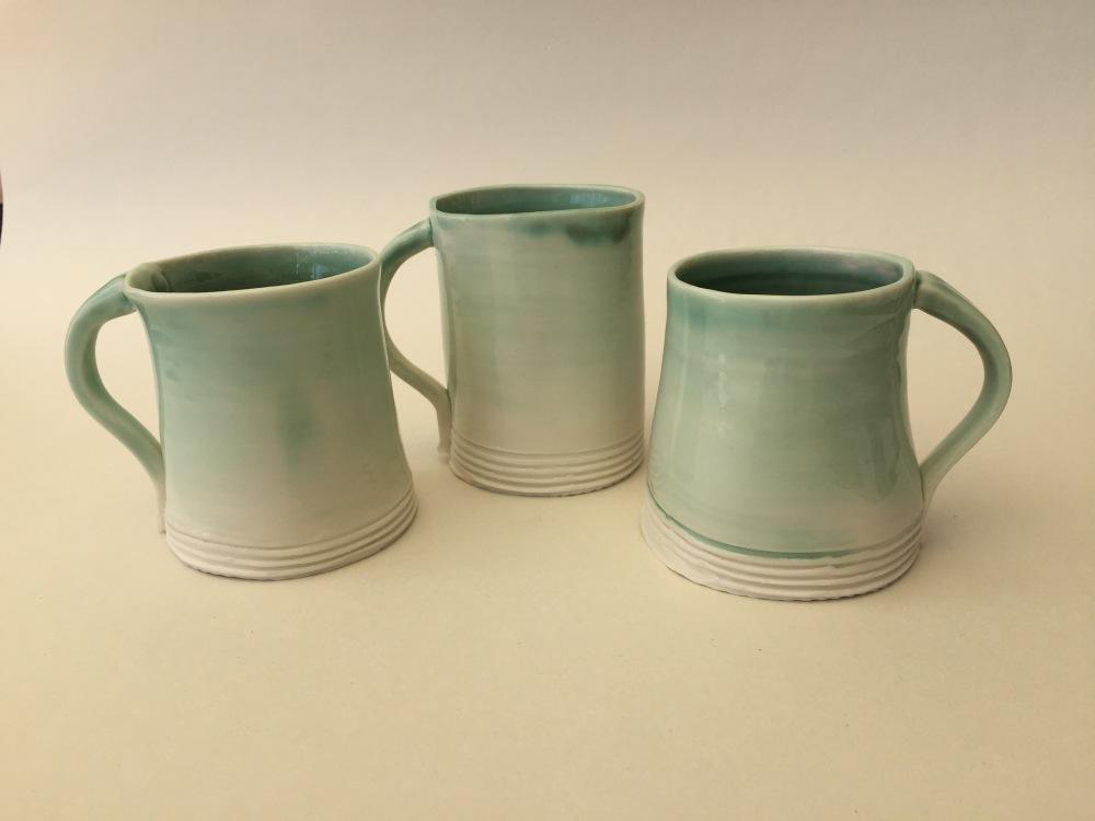 3 green mugs